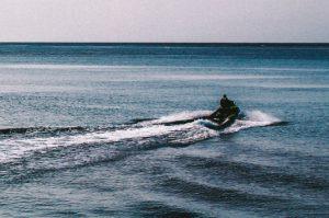 A man riding a jetski